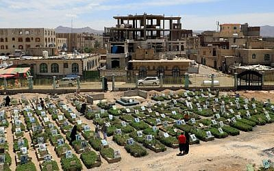 Yemenis visiting a cemetery in the capital Sanaa on April 5, 2019 with graves of victims from the ongoing civil war.  (Mohammed HUWAIS/AFP)