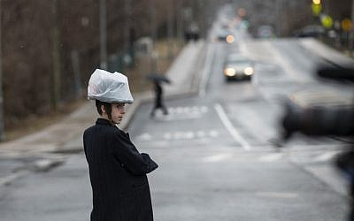 This picture taken on April 5, 2019 shows a boy walking on the street in a Jewish neighborhoods of Nyack, Rockland County, New York. (Johannes Eisele/AFP)