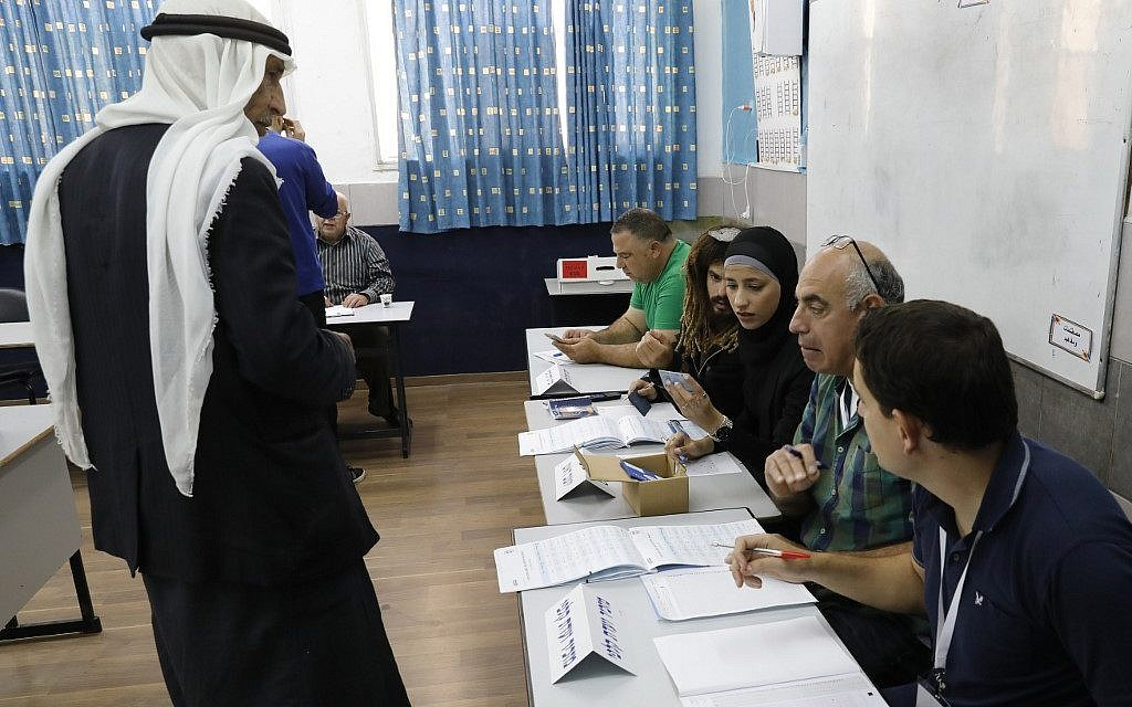 An Arab Israeli man prepares to vote in Israel's parliamentary elections on April 9, 2019, at a school-turned-polling station in the northern Israeli town of Taibe. (Ahmad Gharabli/AFP)