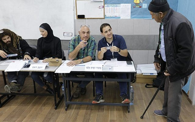 An Israeli man arrives at a polling station to vote in Israel's parliamentary elections on April 9, 2019 in the northern Arab Israeli town of Taibe. (Ahmad Gharabli/AFP)
