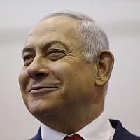 Prime Minister Benjamin Netanyahu smiles as he votes during Israel's parliamentary elections in Jerusalem, on April 9, 2019. (Ariel Schalit/Pool/AFP)