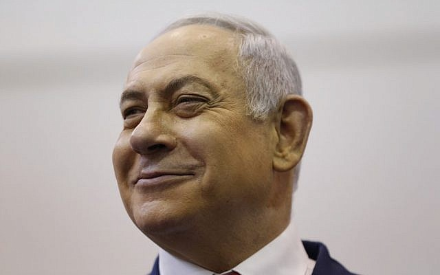 Prime Minister Benjamin Netanyahu smiles as he votes during Israel's parliamentary elections in Jerusalem, on April 9, 2019. (Ariel Schalit/Pool/AFP)