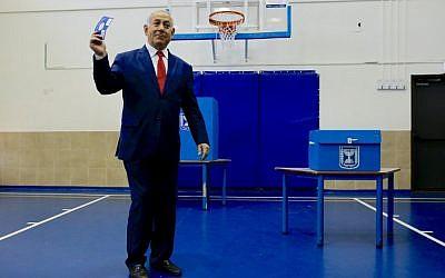 Israeli Prime Minister Benjamin Netanyahu casts his vote during Israel's parliamentary elections in Jerusalem, on April 9, 2019. (Ariel Schalit / POOL / AFP)
