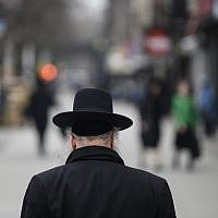 Illustrative: A Jewish man crosses a street in a Haredi Jewish area in Williamsburg, Brooklyn on April 9, 2019 in New York City. (Johannes Eisele/AFP)
