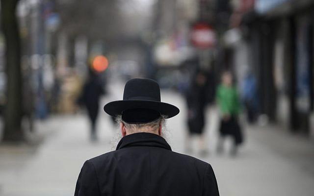 Illustrative: A Jewish man crosses a street in a Haredi Jewish area in Williamsburg, Brooklyn on April 9, 2019 in New York City. (Johannes Eisele/AFP)