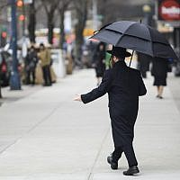 A Jewish man crosses a street in a Haredi Jewish area in Williamsburg, Brooklyn on April 9, 2019 in New York City. (Johannes Eisele/AFP)