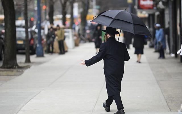 A Jewish man crosses a street in a Haredi Jewish area in Williamsburg, Brooklyn on April 9, 2019 in New York City. (Johannes Eisele/AFP)