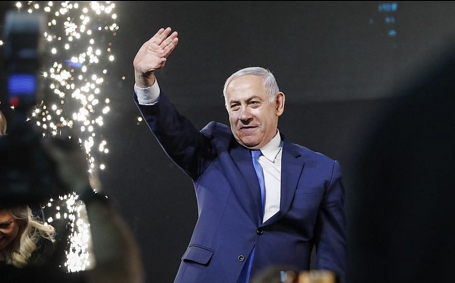 Israeli exit polls show Netanyahu edging ahead of rival
