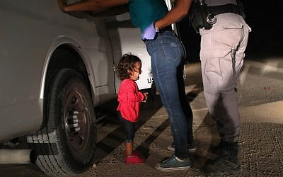In this file photo from June 12, 2018 a two-year-old Honduran asylum seeker cries as her mother is searched and detained near the US-Mexico border in McAllen, Texas. (John Moore/Getty Images North America/AFP)