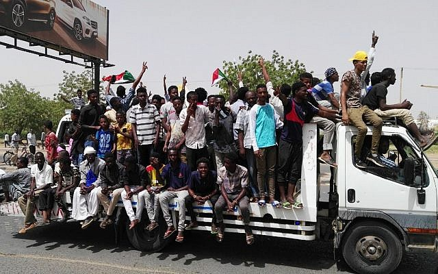 Sudanese men celebrate on April 11, 2019 while rallying in the capital Khartoum. (AFP)
