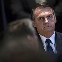 Brazilian President Jair Bolsonaro attends a meeting with evangelical leaders at the Hilton Barra Hotel, in Barra da Tijuca neighborhood, Rio de Janeiro, Brazil on April 11, 2019. (Mauro Pimentel / AFP)
