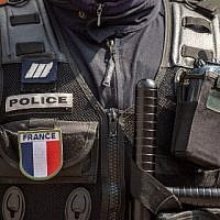 Illustrative. A French policeman standing with his equipment, April 12, 2019. (Christophe SIMON / AFP)