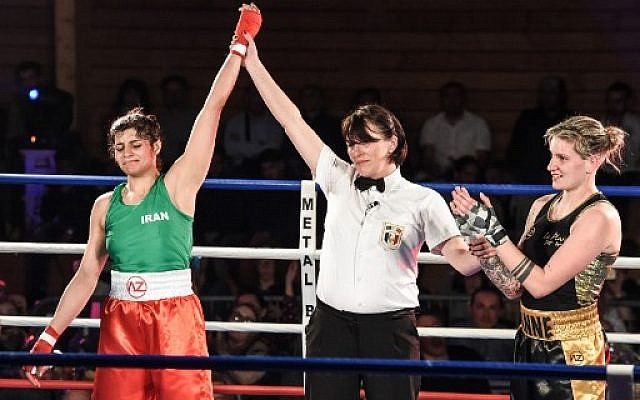 Iran's Sadaf Khadem (L), the first Iranian woman to contest an official boxing fight, is designated winner in her match against France's Anne Chauvin (R) on April 13, 2019 in Royan, western France. (Mehdi Fedouach/AFP)