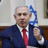 Prime Minister Benjamin Netanyahu speaks during the weekly cabinet meeting in Jerusalem, on April 14, 2019. (RONEN ZVULUN /AFP)