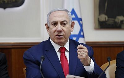 Illustrative: Prime Minister Benjamin Netanyahu speaks during the weekly cabinet meeting in Jerusalem, on April 14, 2019. (RONEN ZVULUN /AFP)