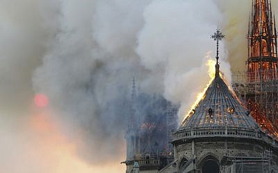 Flames burn the roof of the landmark Notre Dame Cathedral in central Paris on April 15, 2019, during a fire.  (FRANCOIS GUILLOT / AFP)