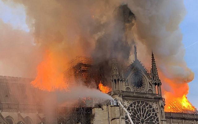 Flames and smoke are seen billowing from the roof at Notre Dame Cathedral in Paris on April 15, 2019.  (Patrick ANIDJAR / AFP)