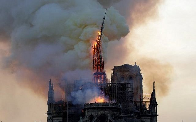 The spire of the landmark Notre Dame Cathedral collapses as the church is engulfed in flames in central Paris on April 15, 2019. (Geoffroy van der Hasselt/AFP)