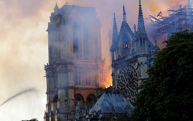 The landmark Notre-Dame Cathedral is engulfed by flames in central Paris on April 15, 2019. (Geoffroy VAN DER HASSELT / AFP)