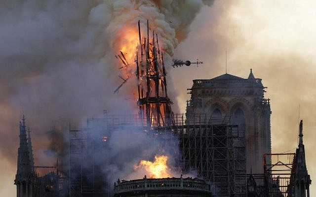 The steeple collapses as smoke and flames engulf the Notre Dame Cathedral in Paris on April 15, 2019. (Geoffroy VAN DER HASSELT / AFP)