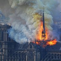 Smoke and flames rise during a fire at the Notre Dame Cathedral in central Paris on April 15, 2019. (Hubert Hitier/AFP)