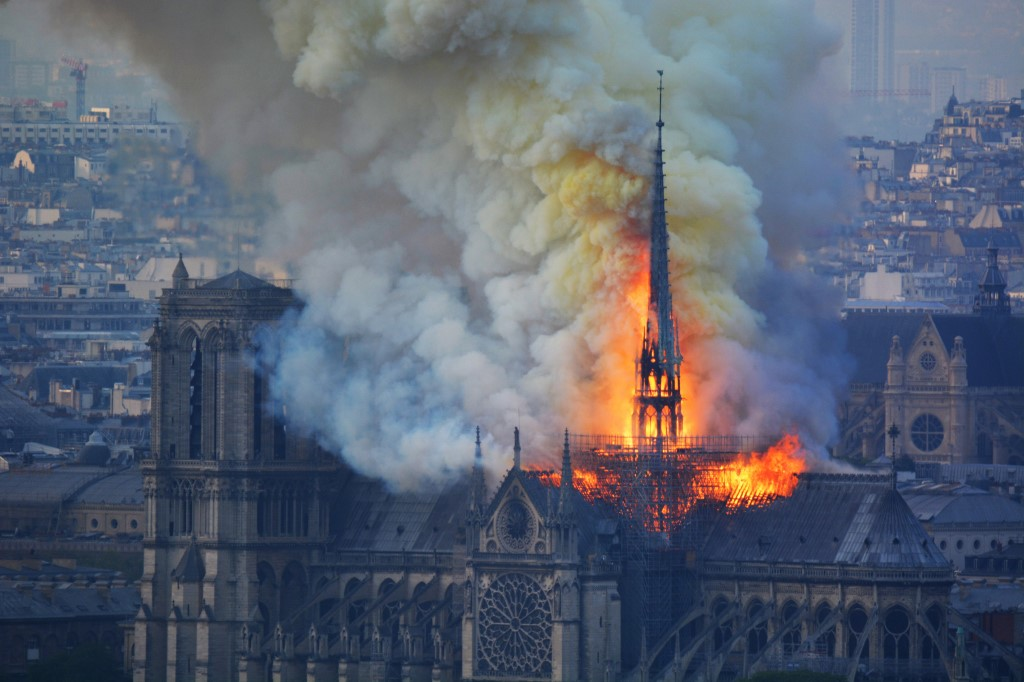 Notre Dame cathedral's spire collapses as roof engulfed by fire