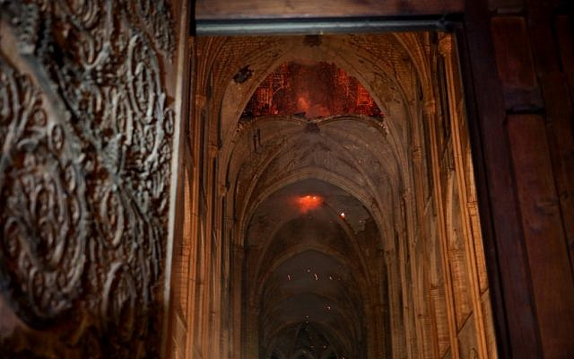 Flames and smoke rise from the interior of Notre-Dame Cathedral in Paris on April 15, 2019, after a fire engulfed the building. (PHILIPPE WOJAZER / POOL / AFP)