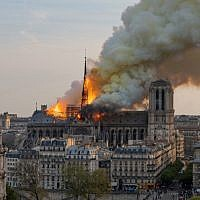 Smoke billows as flames burn through the roof of the Notre-Dame de Paris Cathedral on April 15, 2019, in the French capital Paris. (Fabien Barrau / AFP)