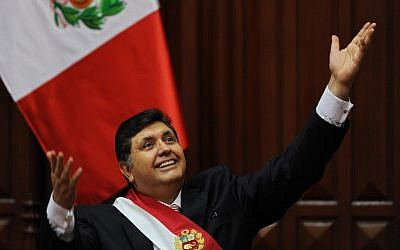 In this file picture taken on July 28, 2009 Peruvian President Alan Garcia gestures at the crowd after delivering a speech for the country's 188th independence anniversary, at the National Congress in Lima. (Ernesto Benavides/AFP)