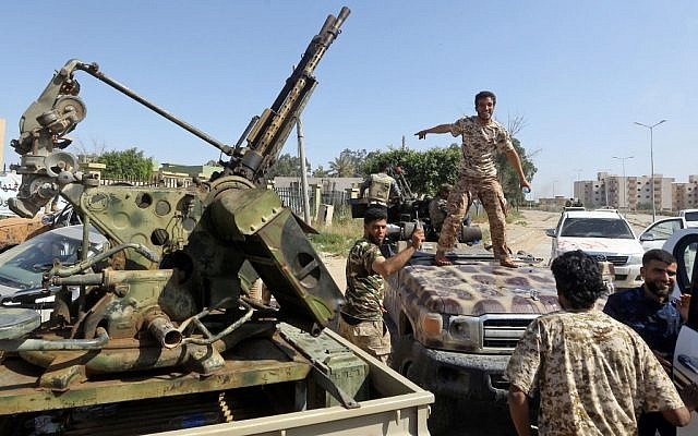 Forces loyal to Libya's Government of National Accord (GNA) gesture on April 18, 2019, after taking control of the area of al-Aziziyah, located some 40 kilometers south of the Libyan capital Tripoli, following fierce clashes with forces loyal to strongman Khalifa Haftar (Mahmud TURKIA / AFP)