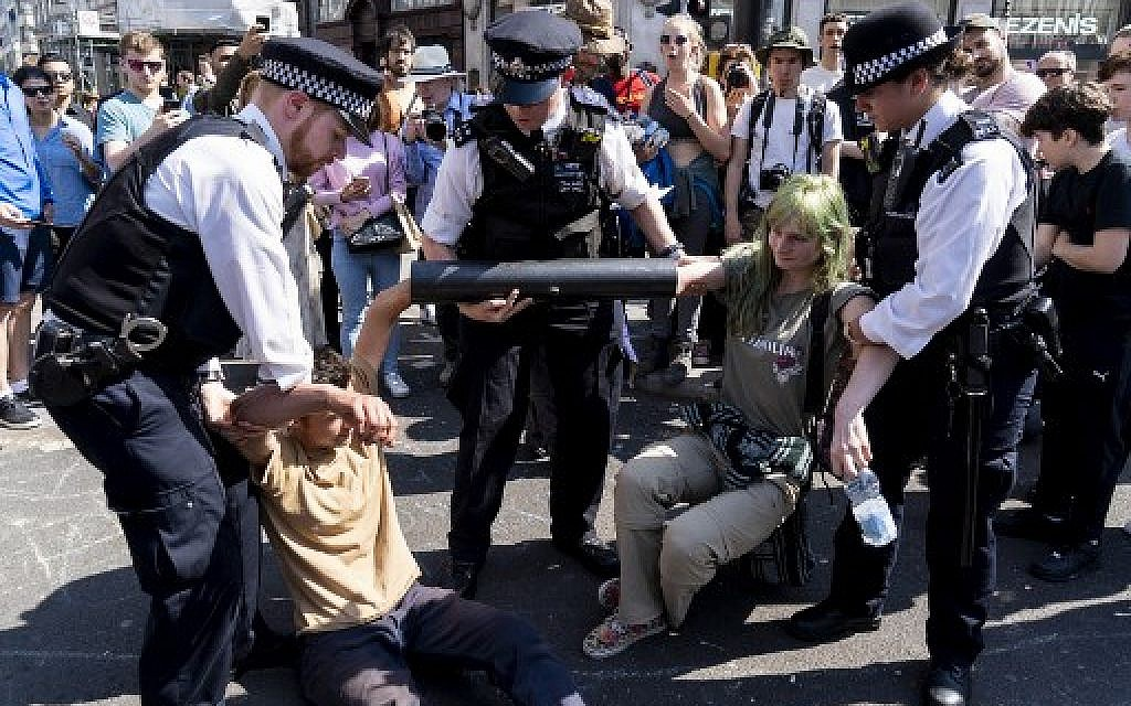Arrests top 700 as climate change protesters in London block Oxford Circus