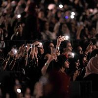 In this file photo taken on March 30, 2018 Saudi women attend a concert by Egyptian pop sensation Tamer Hosny in the western city of Jeddah. (Amer HILABI / AFP)