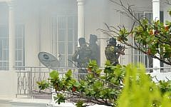 Sri Lankan Special Task Force (STF) personnel are pictured outside a house during a raid -- after a suicide blast had killed police searching the property -- in the Orugodawatta area of the capital Colombo on April 21, 2019, following a series of blasts in churches and hotels.  (ISHARA S. KODIKARA / AFP)