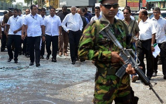Sri Lankan Prime Minister Ranil Wickremasinghe (C) arrives at the site of a bomb attack at St. Anthony's Shrine in Kochchikade in Colombo on April 21, 2019. (ISHARA S. KODIKARA / AFP)