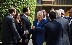 Palestinian Authority President Mahmoud Abbas (C) is greeted upon his arrival at the Arab League headquarters in the Egyptian capital Cairo, to discuss the latest developments in the Palestinian territories on April 21, 2019. (MOHAMED EL-SHAHED / AFP)
