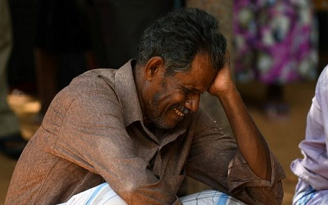 A relative of a Sri Lankan victim of an explosion at a church weeps outside a hospital in Batticaloa in eastern Sri Lanka on April 21, 2019. (LAKRUWAN WANNIARACHCHI / AFP)