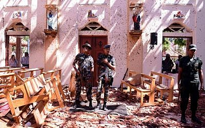 Sri Lankan soldiers look on inside the St Sebastian's Church at Katuwapitiya in Negombo on April 21, 2019, following a bomb blast during the Easter service that killed tens of people. (STR / AFP)