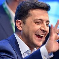 Ukrainian comedian and presidential candidate Volodymyr Zelensky reacts after the announcement of the first exit poll results in the second round of Ukraine's presidential election at his campaign headquarters in Kiev on April 21, 2019. (Photo by Sergei GAPON / AFP)