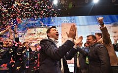 Ukrainian comedian and presidential candidate Volodymyr Zelensky reacts after the announcement of the first exit poll results in the second round of Ukraine's presidential election at his campaign headquarters in Kiev on April 21, 2019. (Genya SAVILOV / AFP)
