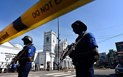 Security personnel stand guard outside St. Anthony's Shrine in Colombo on April 22, 2019, a day after the church was hit in a series of bomb blasts targeting churches and luxury hotels in Sri Lanka. (Jewel SAMAD / AFP)