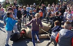 This picture taken on April 19, 2019 shows children using sticks to beat an effigy of Judas on Good Friday, April 19, 2019 in the town of Pruchnik, Poland. (Hubert Lewkowicz / AFP)