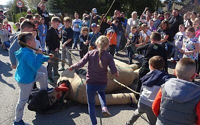 Children using sticks to beat an effigy of Judas on Good Friday, April 19, 2019, in the town of Pruchnik, Poland. (Hubert Lewkowicz / AFP)