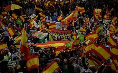 Far-right party Vox supporters wave Spanish flags during campaign rally in Seville on April 24, 2019 ahead of the April 28 general election. (CRISTINA QUICLER / AFP)