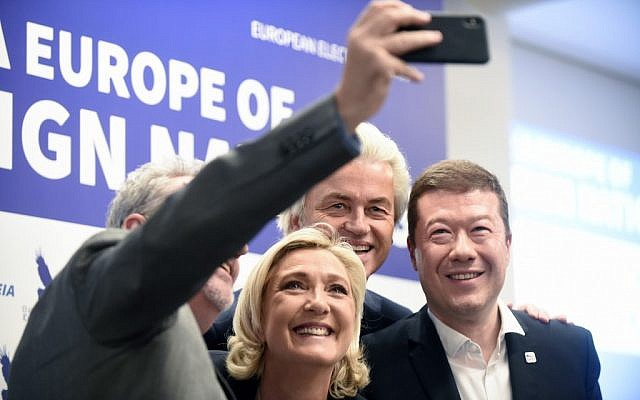 (L to R) Gerolf Annemans, Belgian MEP, Marine Le Pen, head of French far-right National Front (FN) party, Dutch far-right politician Geert Wilders of the PVV party (Partij voor de Vrijheid) and Tomio Okamura, leader of Czech far-right Freedom and Direct Democracy party (SPD) take a selfie after their press conference during a conference of the rightwing Europe of Nations and Freedom (ENF) group in the European parliament on April 25 , 2019 in Prague. (Michal Cizek/AFP)