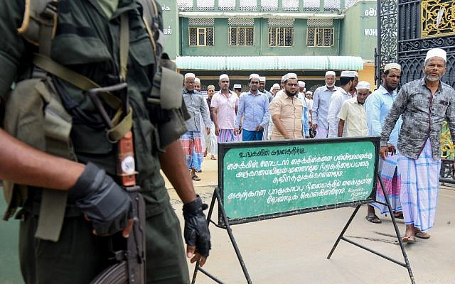 Sri Lankan security personnel stand guard outside Mohideen Meththai Grand Jumma Mosque during the Friday noon prayer in Kattankudy on April 26, 2019, following a series of bomb blasts targeting churches and luxury hotels on Easter Sunday in Sri Lanka (Lakruwan Wanniarachchi/AFP)