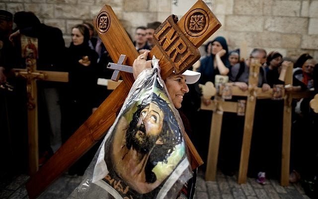 Orthodox Christians from Serbia celebrate the Good Friday in procession on Via Dolorosa in the Old City of Jerusalem, on April 26, 2019. (THOMAS COEX / AFP)