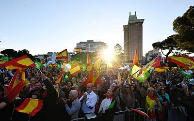 Supporters of Spanish far-right party VOX wave flags during the last campaign rally in Madrid on April 26, 2019 ahead of the April 28 general election. (OSCAR DEL POZO / AFP)