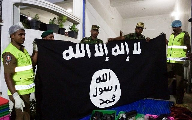 In this picture taken on April 26, 2019, security personnel display seized items after they raid what believed to be an Islamist safe house in the eastern town of Kalmunai (STRINGER / AFP)