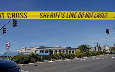 Illustrative photo: Sheriff's crime scene tape is placed in front of the Chabad of Poway Synagogue, after a shooting on April 27, 2019, in Poway, California. (Sandy Huffaker/AFP)
