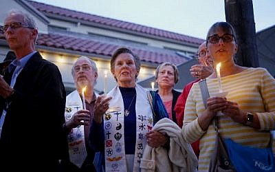 Mourners participate in a candle light vigil for the victims of the Chabad of Poway Synagogue shooting at the Rancho Bernardo Community Presbyterian Church on April 27, 2019, in Poway, California. (SANDY HUFFAKER / AFP)